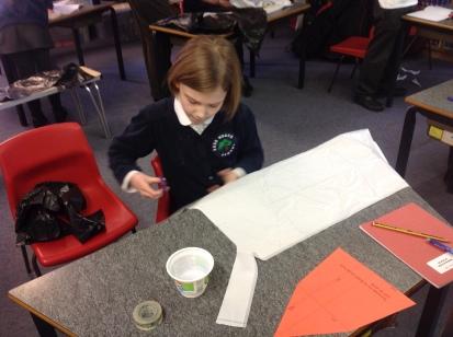 Hannah making her parachute.